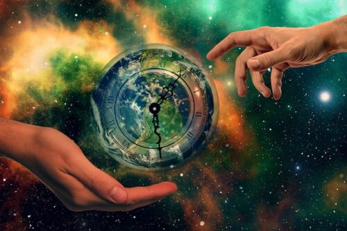 Two hands around an Earth designed clock winding backward into past life vibes.