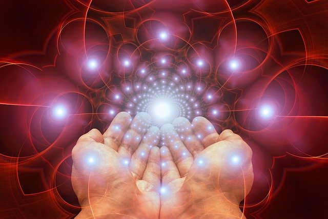 Open palmed hands sending healing reiki energy to someone in another location.